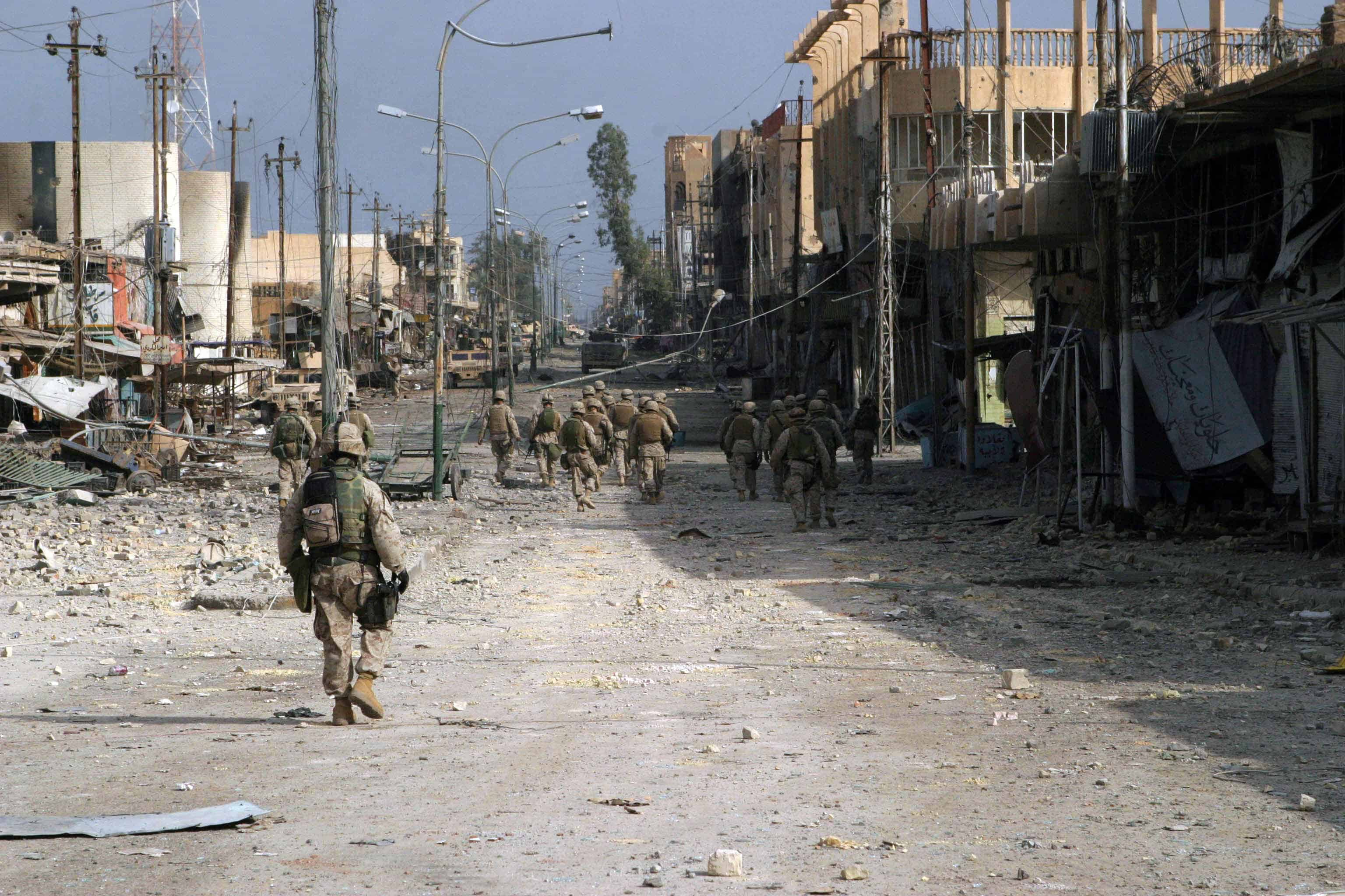 2004; TROOPS WALK THROUGH FALLUJAH
